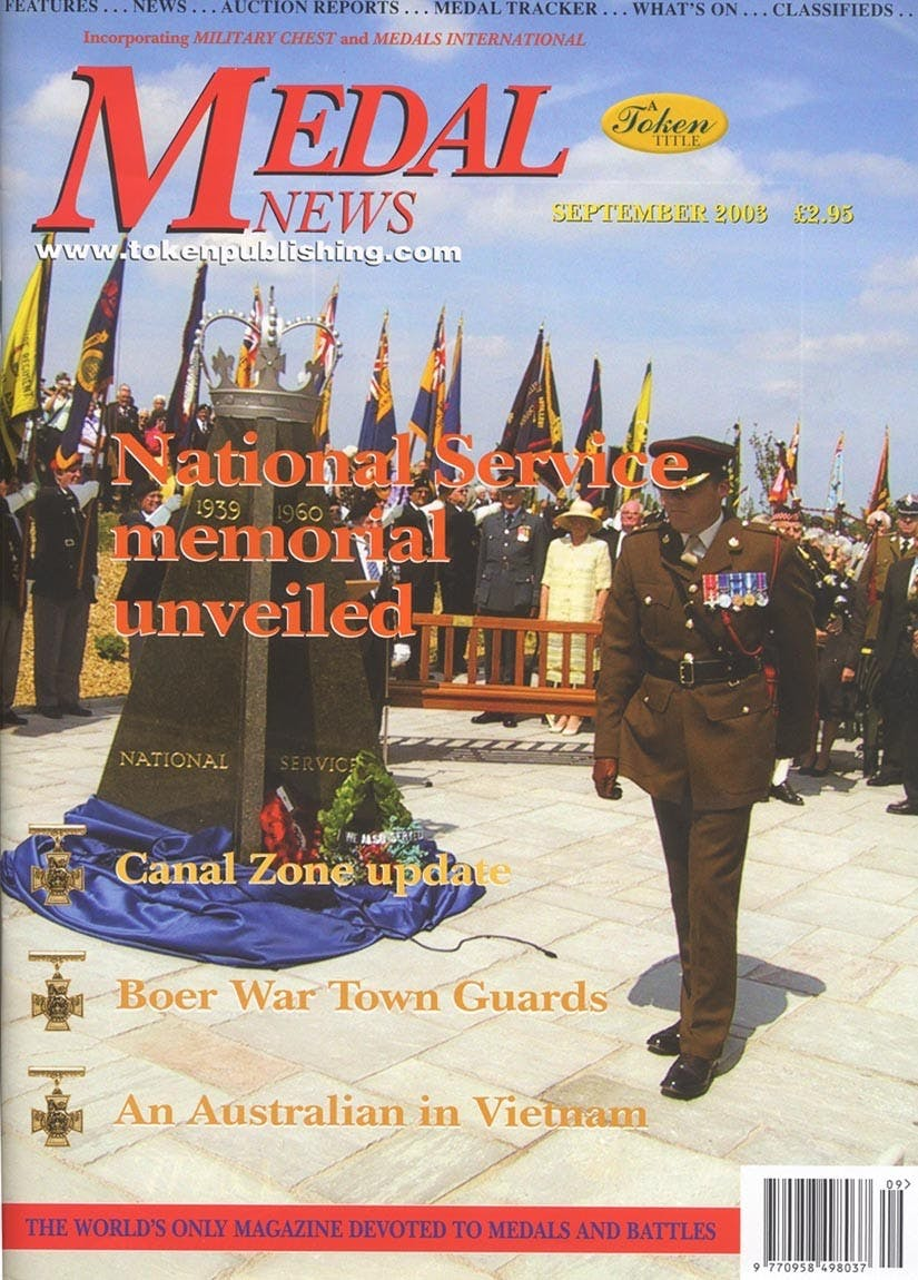 Front cover of 'A helping hand', Medal News September 2003, Volume 41, Number 9 by Token Publishing