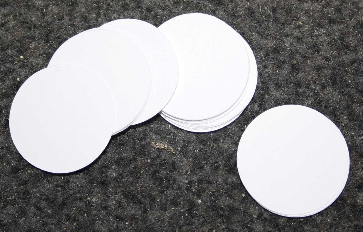 Round white low acid coin tickets 30mm in the Token Publishing Shop
