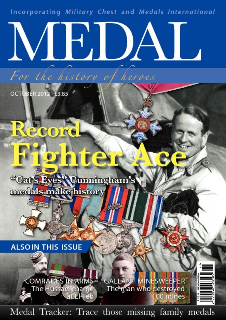 Front cover of 'Record Fighter Ace', Medal News October 2012, Volume 50, Number 9 by Token Publishing