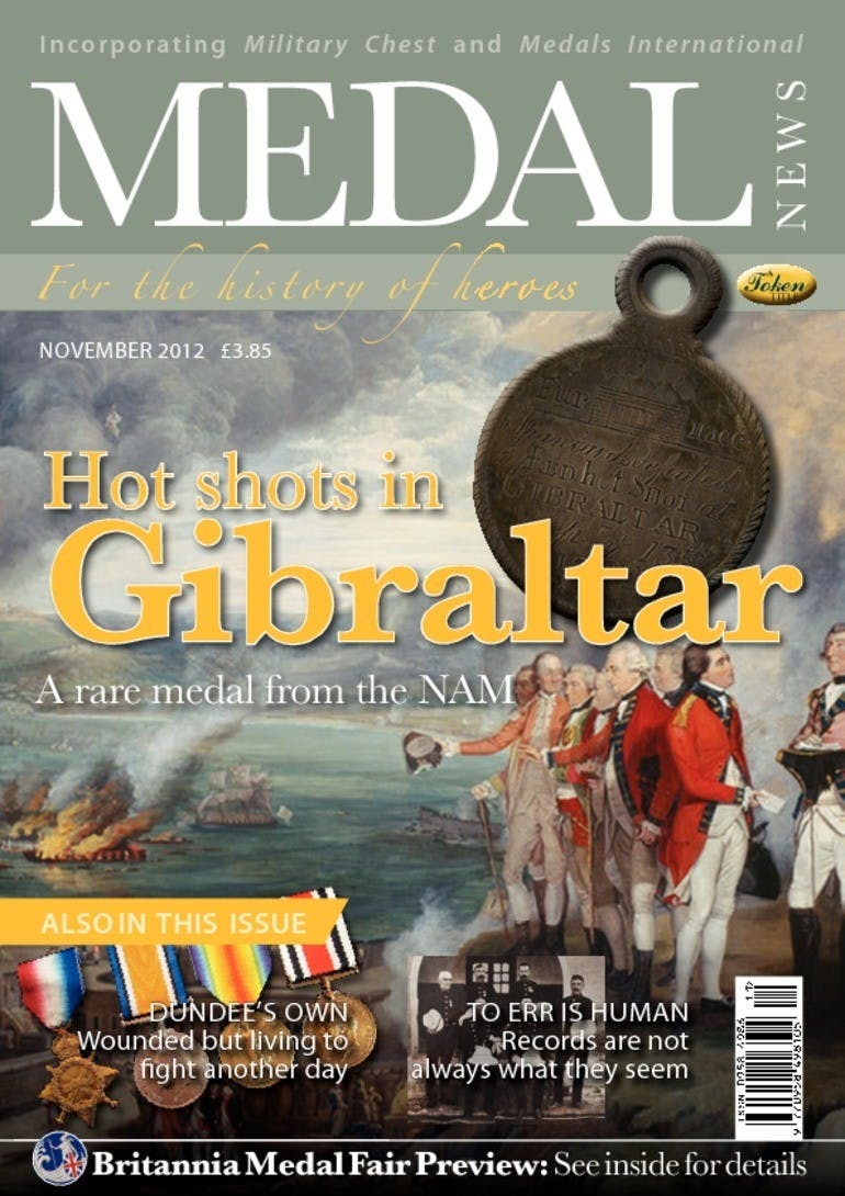Front cover of 'Hot shots in Gibraltar', Medal News November 2012, Volume 50, Number 11 by Token Publishing