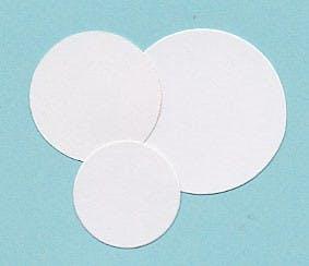 Round white low acid coin tickets 27.5mm in the Token Publishing Shop
